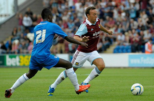 Composed: Mark Noble is one of West Ham's longest serving players
