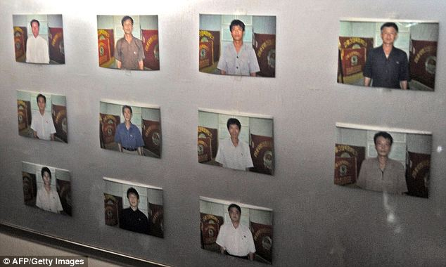 Clued in: Photos of the crew of the Chong Chon Gang hang in the ship. As suspicious Panama authorities went aboard to conduct a search, the ship's captain had a heart attack and attempted suicide