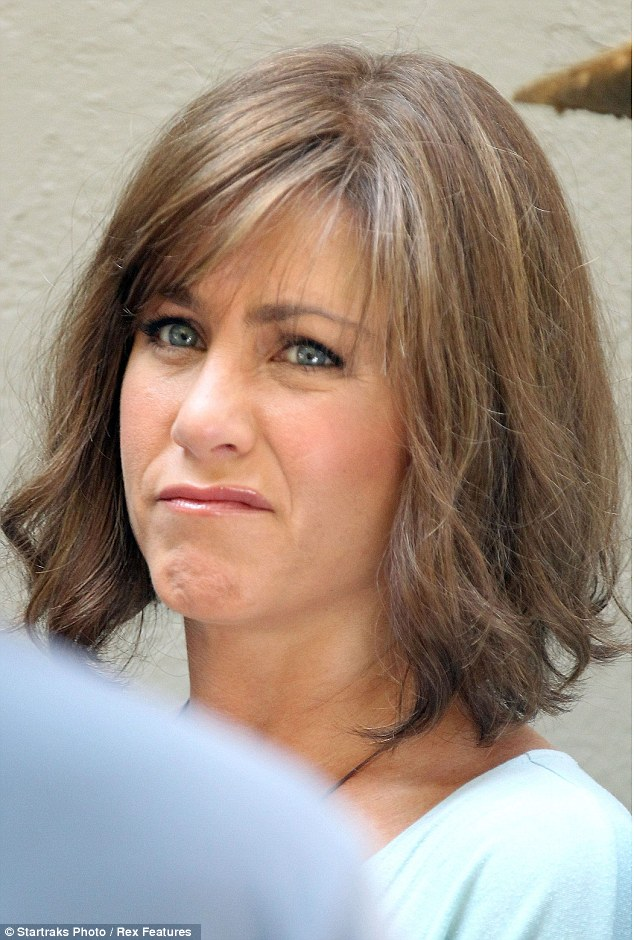 How does my hair look? Jennifer pulled a grimace as she waited on set between takes