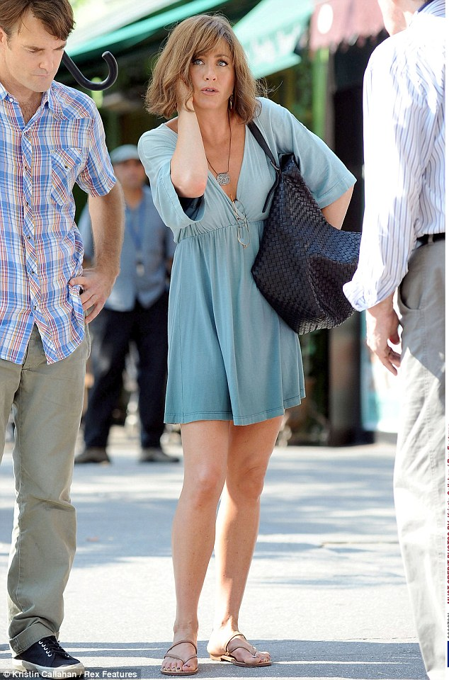 Is that a call from Justin? Jennifer was seen taking a call as she rummaged through her giant black handbag