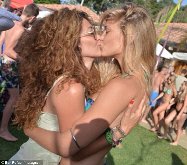 Kissed a girl: Bar Refaeli steals a smooch with friend Orna Elovitch in a pic the model shared on Instagram on Wednesday