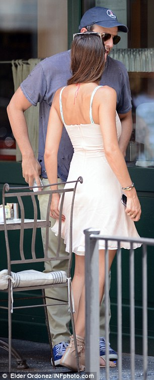 Cute couple: Seth wore khakis, a baseball cap and a T-shirt while Alexi donned a white dress