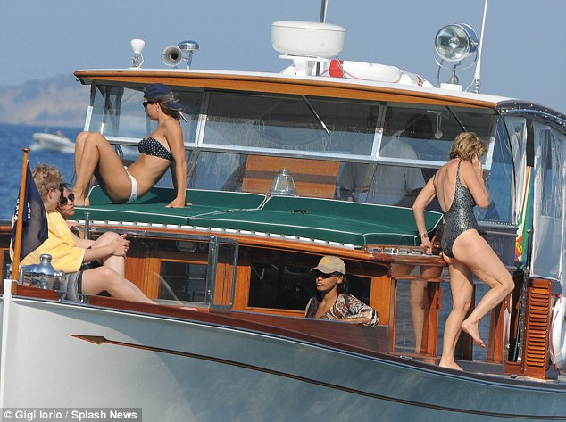 In good company: Kerry and Mariah were seen on the boat with a group of friends enjoying the clear weather