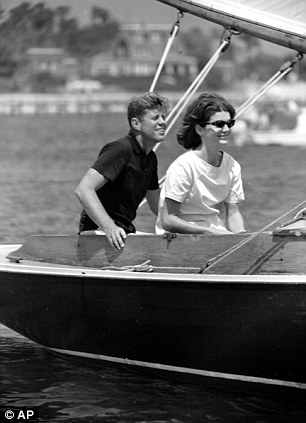 Sen. John F. Kennedy and Jacqueline Kennedy relax aboard the family yacht, Marlin, before sailing around Nantucket sound at Hyannis Port, Ma., on July 19, 1960