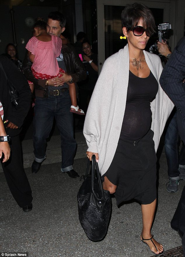 Family flight: The actress was joined by new husband Olivier and her daughter Nahla