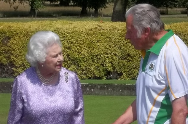 Her Majesty chats to a member of Brimfield and Little Hereford Bowling Club after during a break from a drive around her estate
