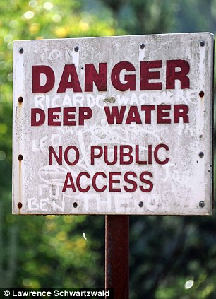 Danger: A sign tells people to keep out of the water at the beauty spot