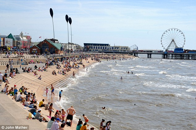 Beach day: The busy seafront at Blackpool today on the hottest day of the year so far
