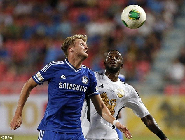 Eyes on the ball: Chelsea's new signing Andre Schurrle vies for the ball ahead of the Singha All-Stars' Lazarus Kaimbi