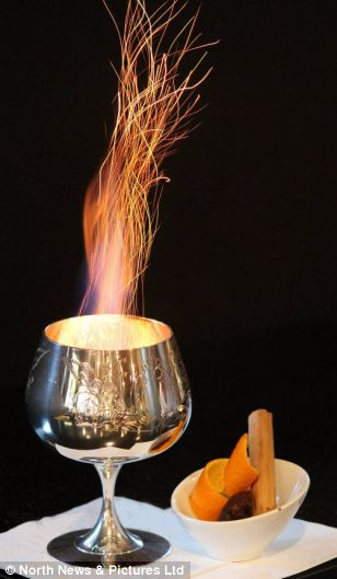 and the flaming cocktail, called Ron Zacapa Blaze, is made from the rum and flamed with Pedro Ximenez sherry at Eau de Vie bar in Sydney