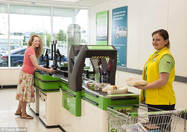 Jill Foster at ASDA's 360 degree checkout with ASDA employee Lauren Day