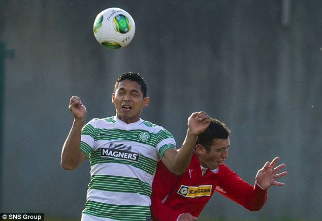 Aerial battle: Emilio Izagiurre (left) goes up for a challenge with Cliftonville's Joe Gormley