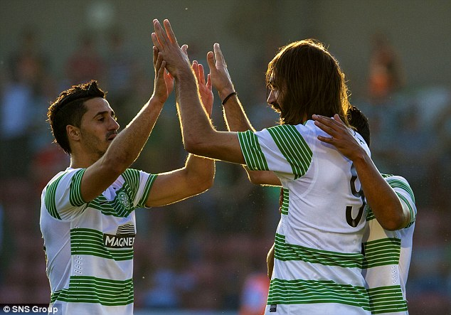 High-fives: Celtic's Beram Kayal celebrates with scorer Georgios Samaras (right) after the second goal