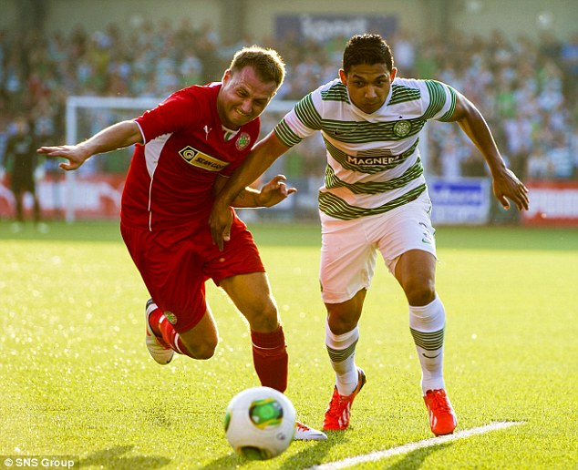 Tussle: Celtic's Emilio Izaguirre (right) races against Cliftonville's Ciaran Caldwell for the ball