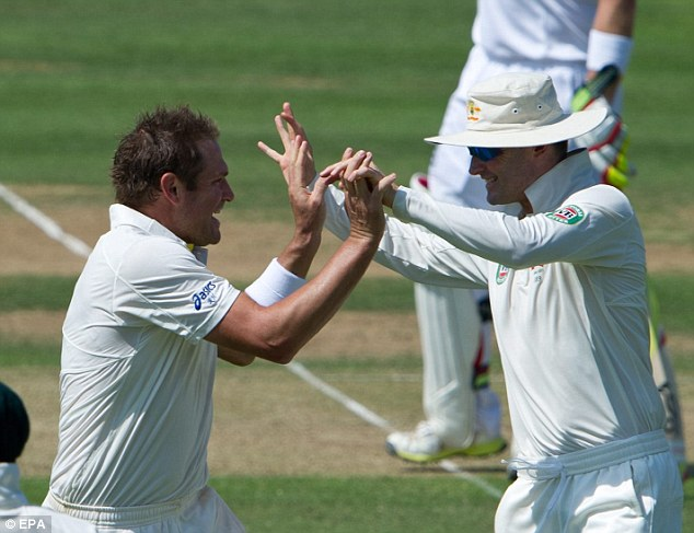 Three and easy: Harris celebrates his third wicket of the day after removing Trott