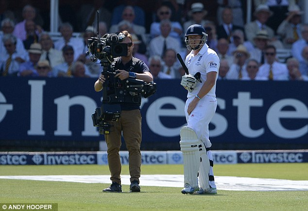 Second chance: Bairstow watches the big screen as Siddle's no-ball is shown up