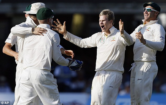 Australia's hero: Steve Smith (second right) celebrates his third wicket, that of Matt Prior