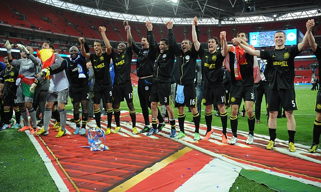 Up for the cup: Glory for Wigan and Swansea showed there is still life in the old cup competitions yet