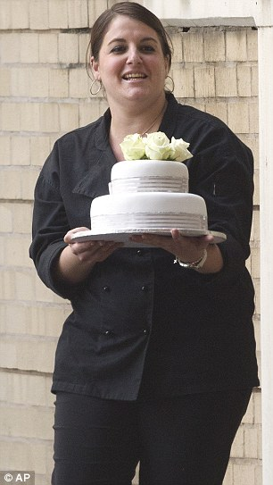 Celebration: This unidentified woman accompanied by former South African President Nelson Mandela's family carries a cake into the  Mediclinic Heart Hospital