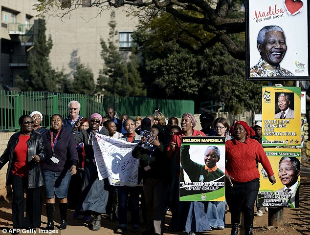 Adoration: A group of people with banners and signs arrive at the Pretoria hospital to wish Mandela a happy birthday