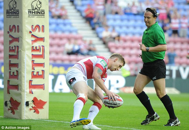 Try: Sam Tomkins touches down against Widnes to help Wigan into the Tetley's Challenge Cup semi-finals