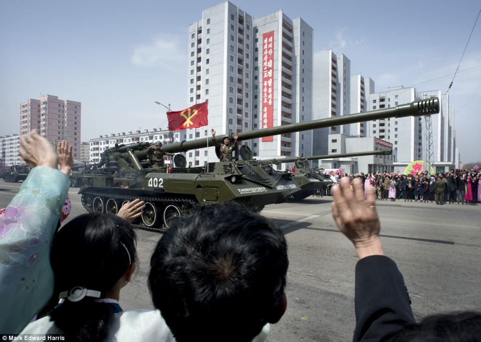 The centenary of Kim Il-Sung's birth, witnessed by photographer Mark Edward Harris, also saw citizens turn out on to the street as military tanks rolled through Pyongyang