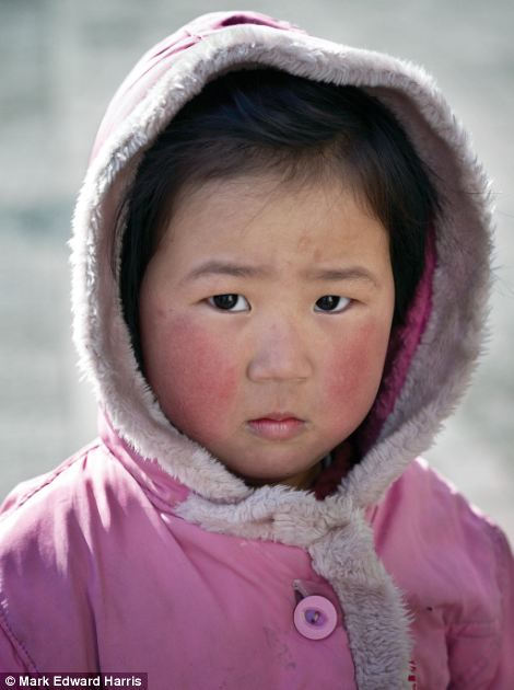 A young girl pictured in Pyongyang, photographed by Mark Edward Harris during his visits to North Korea