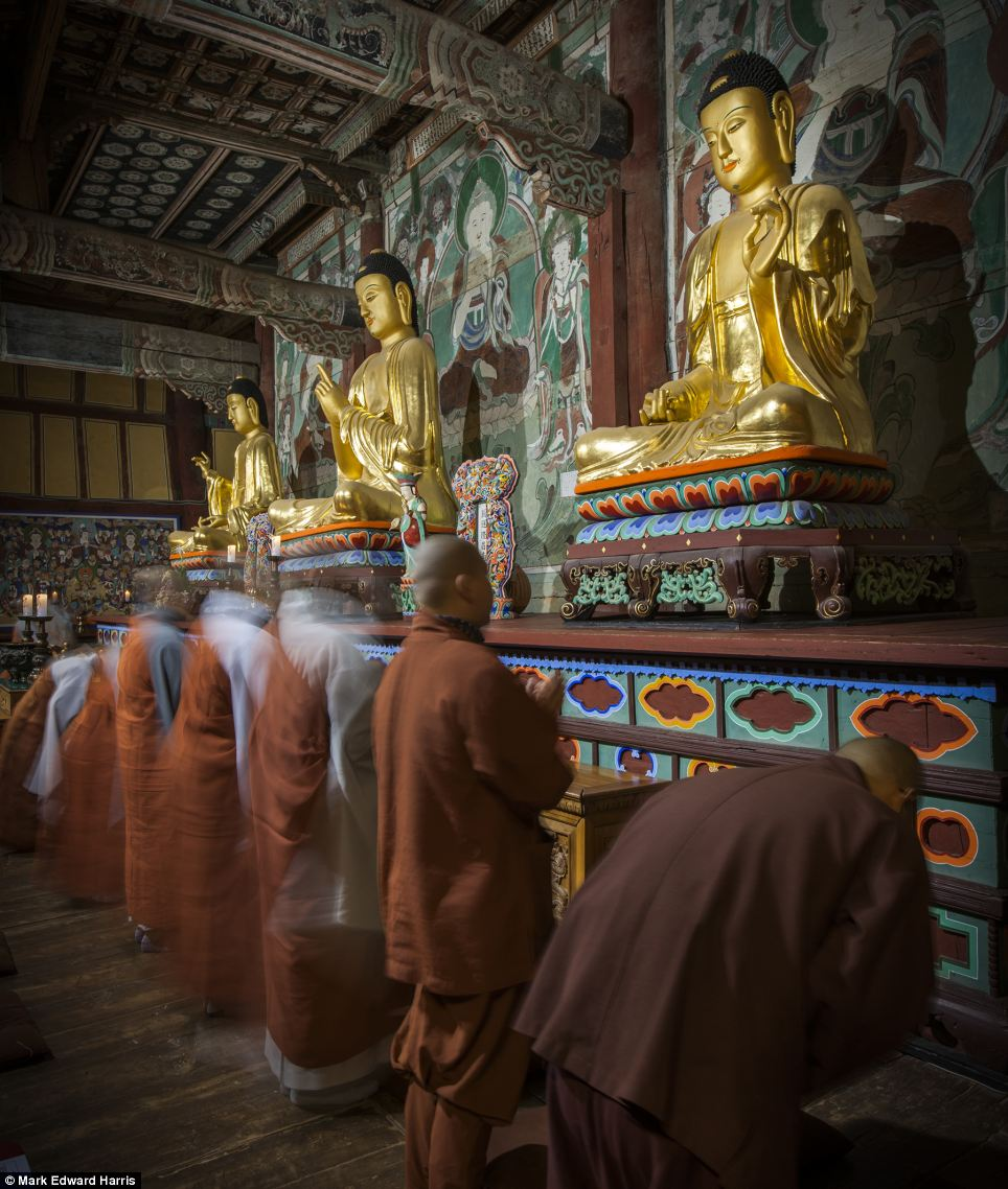 Monks pray at the Buddhist Seonunsa temple near the Yellow Sea coast, which was founded in the sixth century