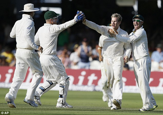 Great spell: Smith is mobbed by his team after a brilliant spell at the death