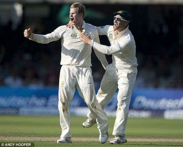 In with a shout: Steve Smith (left) celebrates the wicket of Matt Prior
