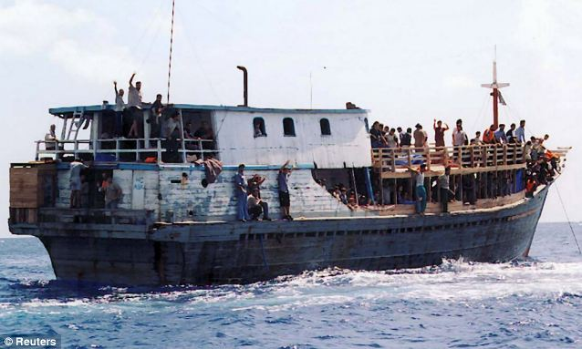 Crackdown: The tough move is designed to prevent people smugglers exploiting refugees and taking vast sums of money putting them on leaky wooden boats such as the one pictured, with false promises that they will be able to make Australia their home