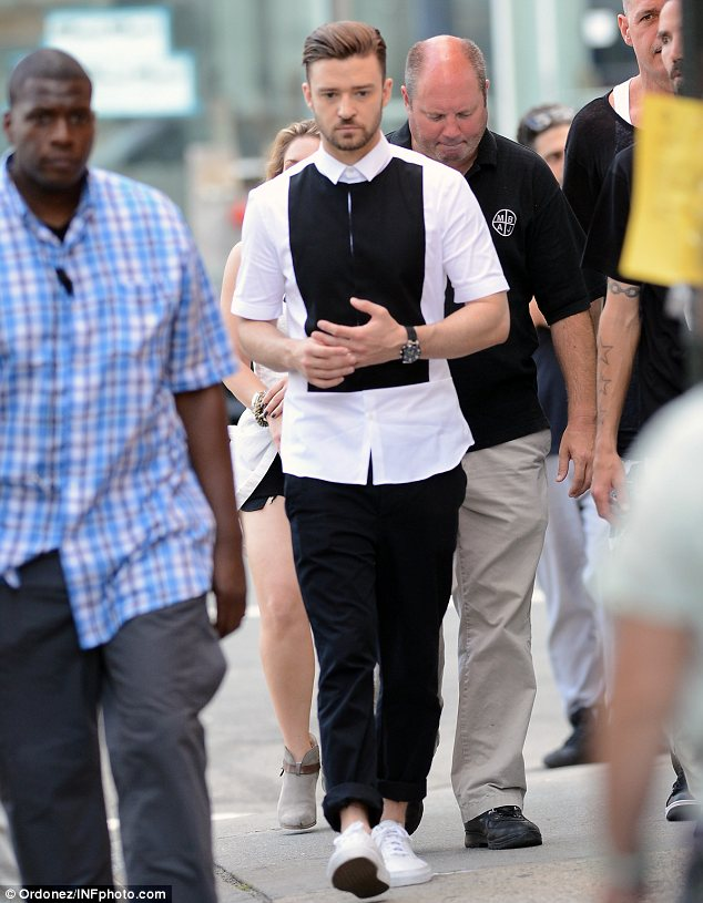 Monochrome man: Justin teamed the shirt with a pair of black trousers that he had rolled up and a pair of white pumps