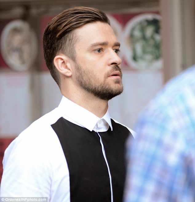 Short back and sides: The former boyband singer showed off a slick new haircut on set