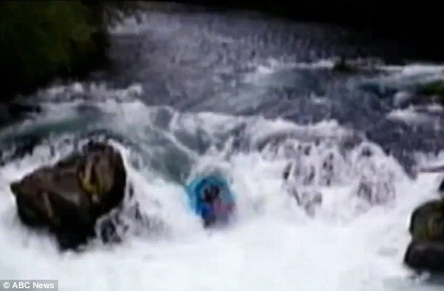 The small raft carrying four people plunged over the 14-foot Husum Falls causing one of the passengers to fall out