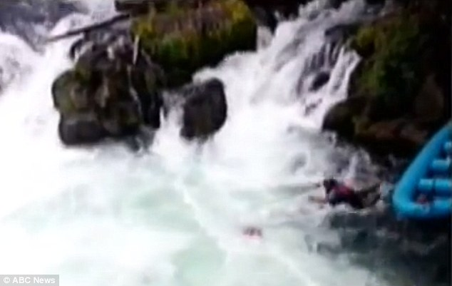 Dramatic: River guide Russ Cole dived into the rapids from a nearby raft to rescue the man