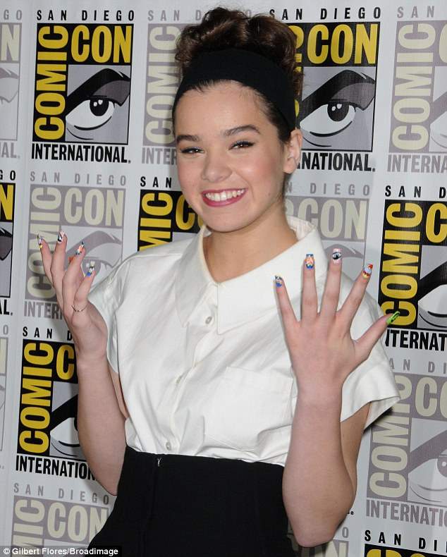 Razzle-dazzle: Hailee showed off her multi-coloured nail polish as she flashed a proud grin
