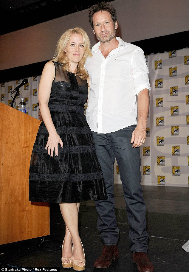Lady and the cool dude: While Gillian was elegant in a strapless black frock, David stayed casual in a white button-down shirt and grey trousers