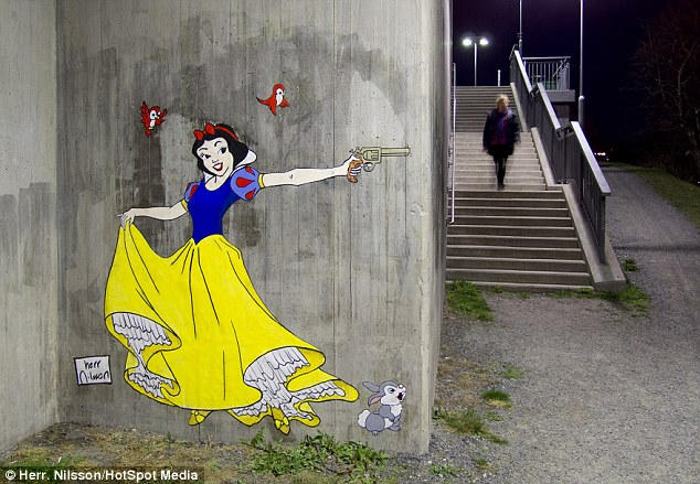 Snow Fright:  An anonymous Swedish artist who goes by the name Herr. Nilsson has turned some of Disney's best-loved characters such as Snow White, pictured, into evil killers in his street art around Stockholm, Sweden