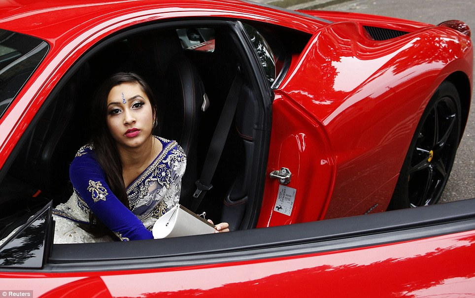 Glamour: Halima Miah, 16, arrives for her graduation event in a Ferrari - a trend that is growing in this part of London