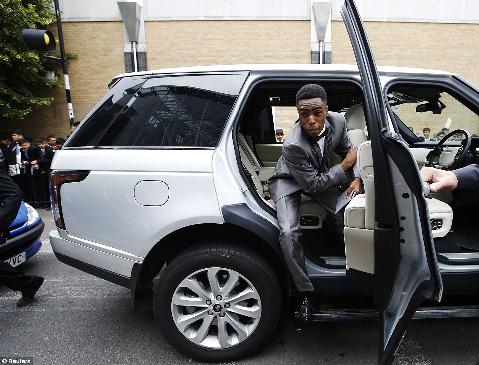 Springing into action: Stephan Bolompa, 16, leaps out of a Range Rover to have fun with his friends at the prom
