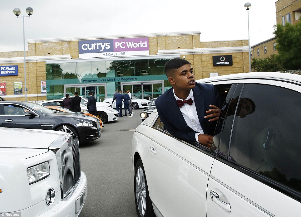 Getting some air: Samad Ahmed, 16, leans out of a Maybach limo and yells to friends as they leave a car park