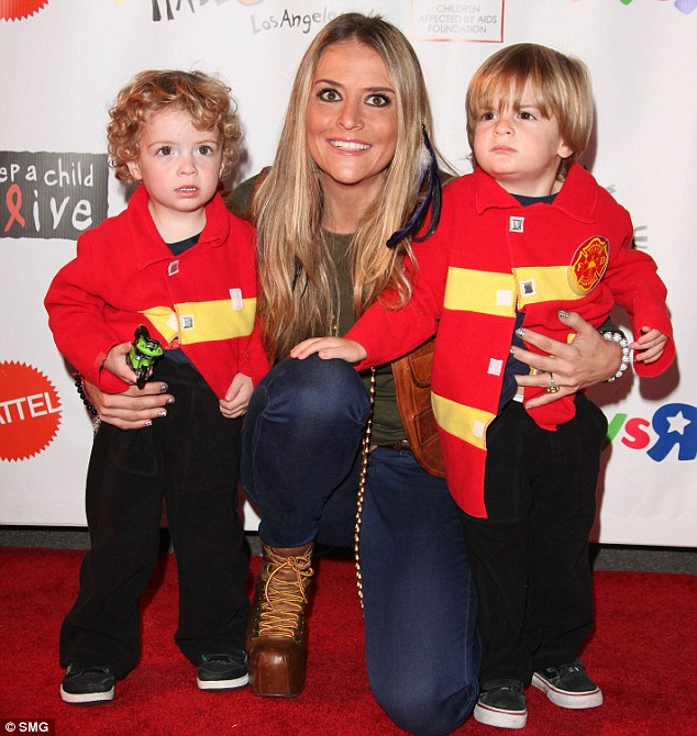 Constant monitoring: Los Angeles County Department of Children and Family Services will only allow the socialite's, seen here with Bob and Max at an event in 2011, case to go back to court if she fulfills five specific conditions