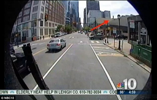 Collapse: This bus surveillance footage shows how a building fell down in the centre of Philadelphia