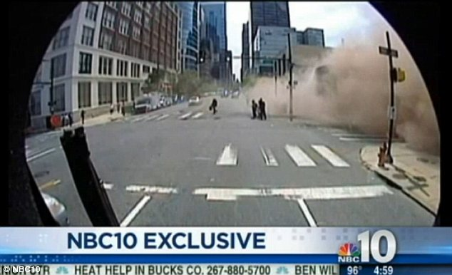 Horror: The building sent up plumes of smoke and dust coating central Philadelphia in debris