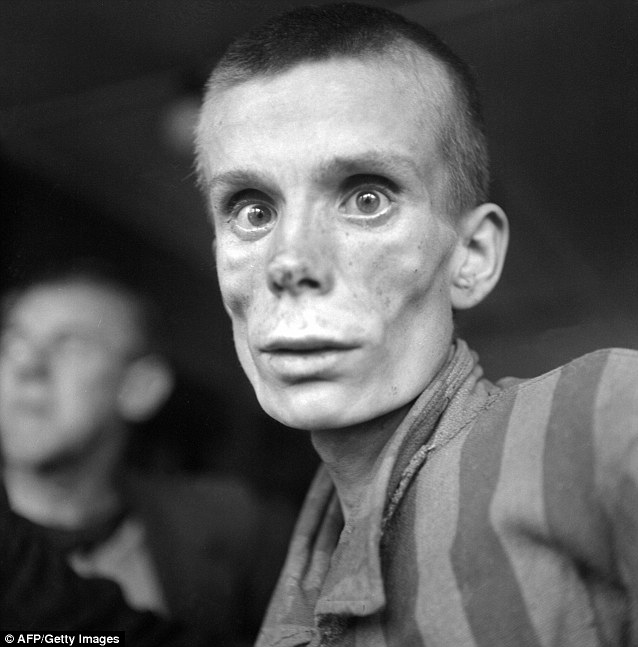 Extermination: A prisoner at the Dachau concentration camp, where over 30,000 Jews were killed during the Holocaust