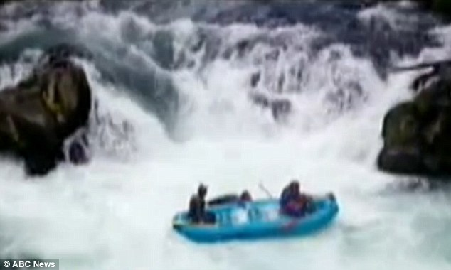 Caught on tape: The man is knocked out of the raft by another patron before floating down the river