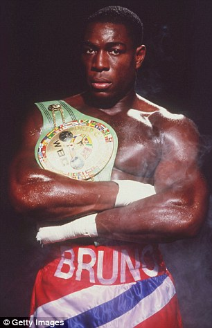 Proud: Frank Bruno posing with the WBC belt he went on to lose to Mike Tyson