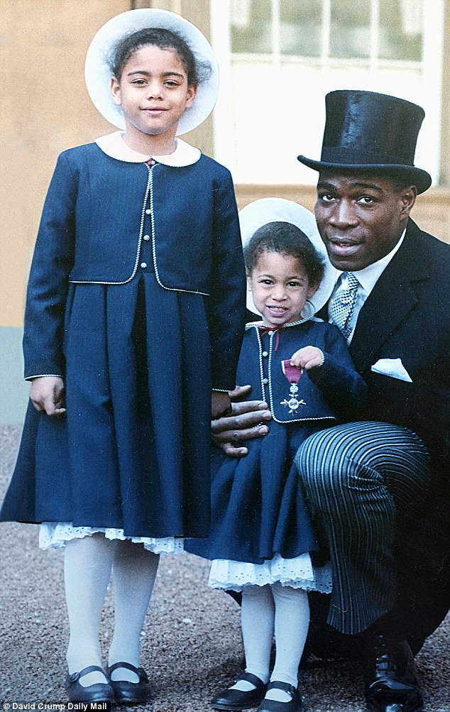 History: Frank Bruno after receiving his MBE in 1990, with children Nicola age eight at the time and Rachel age four