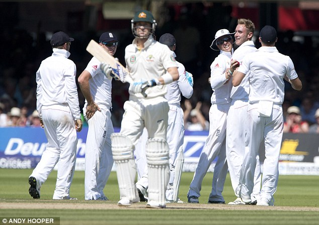 Prize scalp: Clarke makes his way back to the pavilion as England congratulate bowler Broad