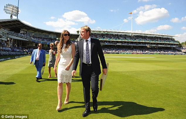 Critic: Shane Warne walks with Elizabeth Hurley after being inducted into the ICC Hall of Fame on Friday